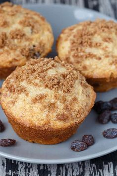 The most delicious Cinnamon Raisin Muffins EVER! These muffins are light, moist, speckled with raisins, and topped with cinnamon-sugar.