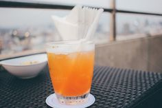 Cocktail glass in rooftop bar by Nuchylee Photo on Creative Market