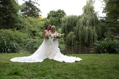 Bride and bridesmaid with pond background photo