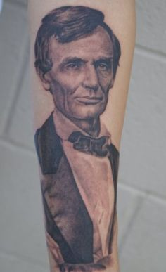 Abraham Lincoln tattoo by Tom Renshaw. I have to admit, this is pretty bada$$.
