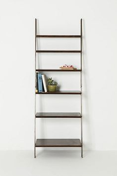 Green Street Shelves Anthropologie This Blackened Steel Wood Console Leans Against The Wall With