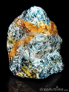 Apatite, phosphate mineral. Isolated black background.