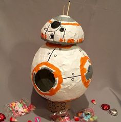 A step by step guide on how to make a paper mache BB8 droid from the Star WarsThe Force Awakens movie. A fairly simple project to complete. Here's what you will need: paper mache- one small half circle, two large half circles duct tape (and perhaps an ace bandage) craft paint in white, orange, gray, …