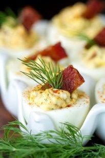 These Deviled Eggs with Candied Bacon are delicious! Made with mayonnaise, whole grain mustard, bacon, dill and a few other goodies!