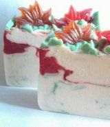 Mmmmmmm...Candy and pine.  A lovely, sweet pine fragrance that injects Christmas spirit right into your skin!  I used high quality glycerin soap for the poinsettias and the nice vein of sparkling red running through the soap.  When held up to the light it glows with Yuletide magic!  Shipping is included in product price.