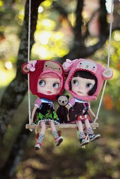 Blythe dolls swinging with their Lalatroop sheep hats on.