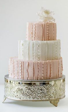 Found on WeddingMeYou.com - Unique Wedding Cake Designs - Ruffles and ribbons pastel pink #weddingcake