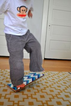balance board toy for active kids. I may have to make this for an indoor winter activity!!!