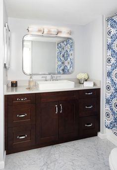 Chery Cabinets. Haze Ceasarstone. Drop in sink. Chrome Fixtures. Carerra Marble Flooring. Bathroom Rennovation. Interior Design by Laura Fox Interior Design, LLC. Photo credit to Stacy Zarin Goldberg