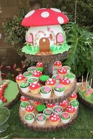 Beautiful toadstool cake and cupcakes.