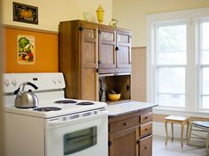 at our cottage: Bright, newly painted kitchen with rocking chair by window for morning coffee.