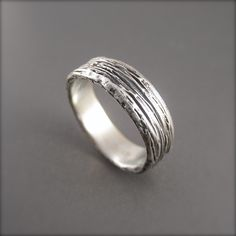 Almost looks like maple bark--perfect for the wood-worker in the family! Timber Sterling Silver Wedding Ring by Beth Millner Jewelry- www.bethmillner.com