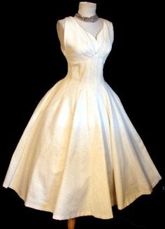 Vintage 50s wedding dress <3  seriously starting to think I was born in the wrong era.... I love the look of vintage clothes!!