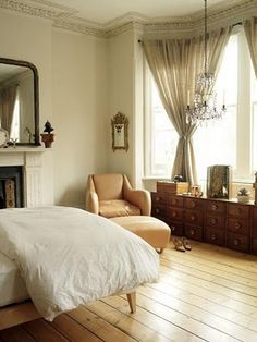 everything about this bedroom. the moulding, the floor plan, the fireplace, the beautiful window. the chandelier.