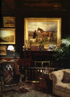Library inspiration for the gentleman - dark walls, gold framed artwork, fireplace, leather tufted chair - from the Madison Avenue Ralph Lauren store