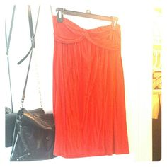 """Red Flowy Dress Looks great with leggings or tights, or bare legged with boots!  I'm 5'2"""" and it comes just slightly above my knees.  Size medium but fits more like small.  Super cute for summer or the beach.  Small stain on the back visible in photos. Dresses"""