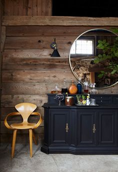 Our Metal Framed Round Wall Mirror lookin' snazzy in this show-stopping 120 year-old barn makeover on the Emily Henderson blog!