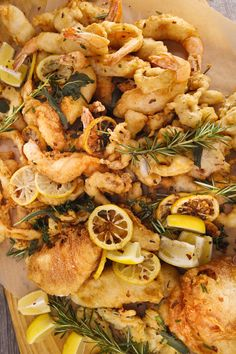 Put your table-top fryer to good use and make this autumn seafood fritto misto with rosemary, Old Bay and sliced lemon.