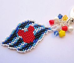 love this seed bead charm from etsy seller: migotochou