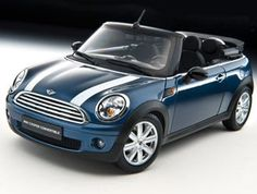 This Mini Cooper Convertible (2009) Diecast Model Car is Blue and features working steering, suspension, wheels and also opening bonnet with engine, boot, doors. It is made by Kyosho and is 1:18 scale (approx. 20cm / 7.9in long). Comes with two detachable roofs in closed and open positions....