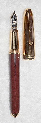 Cartier, Louis Cartier Vermeil & Burgundy Lacque Fountain Pen, Fine Nib.  Not many were made, and are now virtually lost amongst collectors.  It cannot be found on the Web.  What a masterpiece of craftsmanship!  If only it were an XF nib, and if only the cap pulled off, and pushed on, instead of a long screwing and unscrewing process.