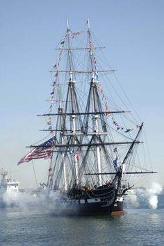 The USS Constitution, the world's oldest commissioned warship afloat, fires its starboard guns while underway in Massachusetts Bay on July 21, 1997.