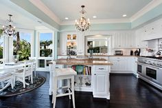 Lovely white kitchen with dark wide plank flooring