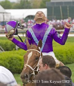 Mike Smith celebrates after winning the Kentucky Oaks on Princess of Sylmar
