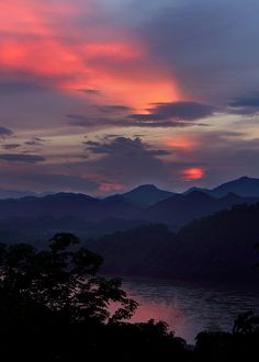The sun setting over the Mekong River in Luang Prabang, Laos.  Taken from That Chomsi. Photo by .Rob Kroenert