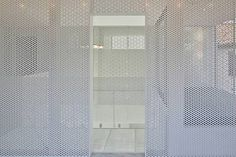 Japanese architects StudioGreenBlue have completed a house in Kōnosu City, Saitama Prefecuture, Japan, with an interior featuring white perforated screens throughout the space.