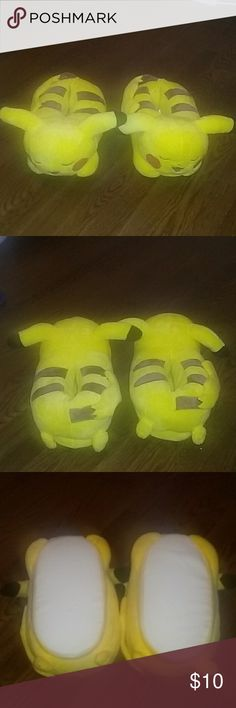 New Pikachu Slippers NWOT Pikachu Slippers. I'm a size 9 1/2 or 10 in womans and these fit me perfectly. Super comfy! Thinkgeek Shoes Slippers