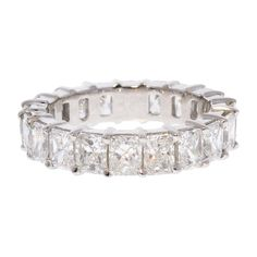 For Sale on - This is an impressive eternity wedding band that boasts 20 radiant cut diamonds that have been expertly prong set all the way around totaling carats. Radiant Cut Diamond, Pear Diamond, Eternity Ring Diamond, Emerald Cut Diamonds, Diamond Stone, Diamond Cuts, Modern Wedding Rings, Stacked Wedding Bands, Cushion Cut Diamonds