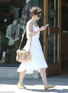 Checking in: The actress scrolled through her phone as she walked down a street in Beverly...