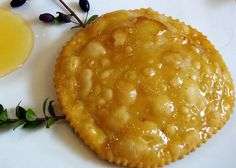 Sebadas with cheese and honey - These are a well known dessert in Sardinia. They are filled with a sweetened goat cheese and topped with honey. Can you taste the Mediterranean? Recipe below!