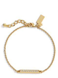 Sparkly crystals decorate the minimalist shape of this gold-plated Kate Spade bracelet that layers well.