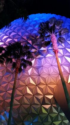 Epcot's Spaceship Earth through the palms