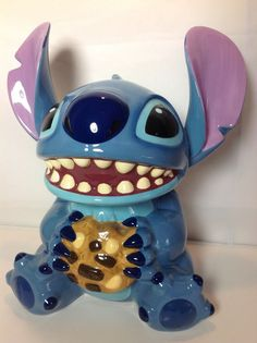 Disney Stitch Cookie Jar. It looks like he's holding a bag of puke.....yeeeeeaaaaaah