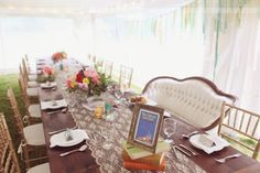 Talk about an absolutely lovely head wedding table... with a lace runner, antique books, and gorgeous centerpiece flowers!  Plus, a vintage couch for the bride and groom to share?  Perfection.  Photography from one of our favorite Anthropologie styled weddings at the vintage & rustic Cape Cod wedding venue – The Overbrook House