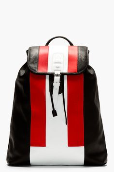 Pebbled leather colorblocked backpack in, black, red, and white. Padded leather carrying handle. Foldover flap with magnetized snap closure and mock pin-buckle detail. http://www.zocko.com/z/JFD85