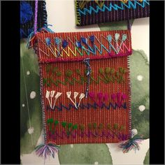 """Mexican handmade bag No two alike! Colorful details, pretty rope strong, that can be knotted for different lengths. Handmade and decorated in the beautiful seaside town of Veracruz, Mexico. Fold down flap and tie closure. 6.25"""" W X 7.75"""" L, strap is 21.5"""" L to top of bag. Also see listings in black and purple! Costume Baldor Bags Crossbody Bags"""