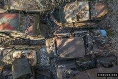 They are almost covered in old leaves.  The remote Swedish scrapyard where old cars rust in peace! Photographed with a drone. https://airbuzz.one/drone-pictures-of-bastnas-car-cemetery/ #dronephoto #droneblogg #djiblogg #djimavicpro #dji #carcemetery #sweden #carwrecks #oldcars #rustycars #cars #sweden #bilskroten #båstnäs #dronephotography