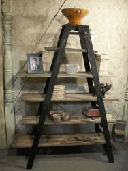 We get lots of requests for ladder shelving made from our antique ladders. We used 2 vintage ladders then removed the backs and attached them together