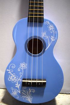Soprano ukulele with hand-painted design: flowering vine