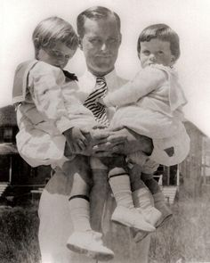 Early Years: Father and Sons - Joseph P. Kennedy holds sons Joseph Patrick Junior (left) and two-year-old future president John Fitzgerald Kennedy, in 1919.