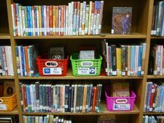 Genius!  Book baskets on the shelves for the popular series.  The baskets are located in the proper location instead of a separate part of the library!