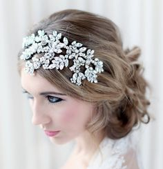 This stunning side detail headband is a real statement piece, with swarovski crystal navette vines enhance by tiny clear swarovski crystals and pearls.
