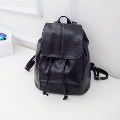 7a4be2640f Are you are looking for a classic black backpack that can carry all your  essentials but