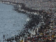 Why I stay inside Christmas Eve through the Epiphany: People crowd onto Ipanema beach in Rio de Janeiro, Brazil