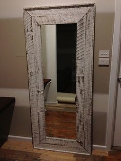 Mirror frame I made from old fence palings and finished with whitewash