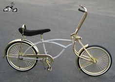 Gold lowrider bike.
